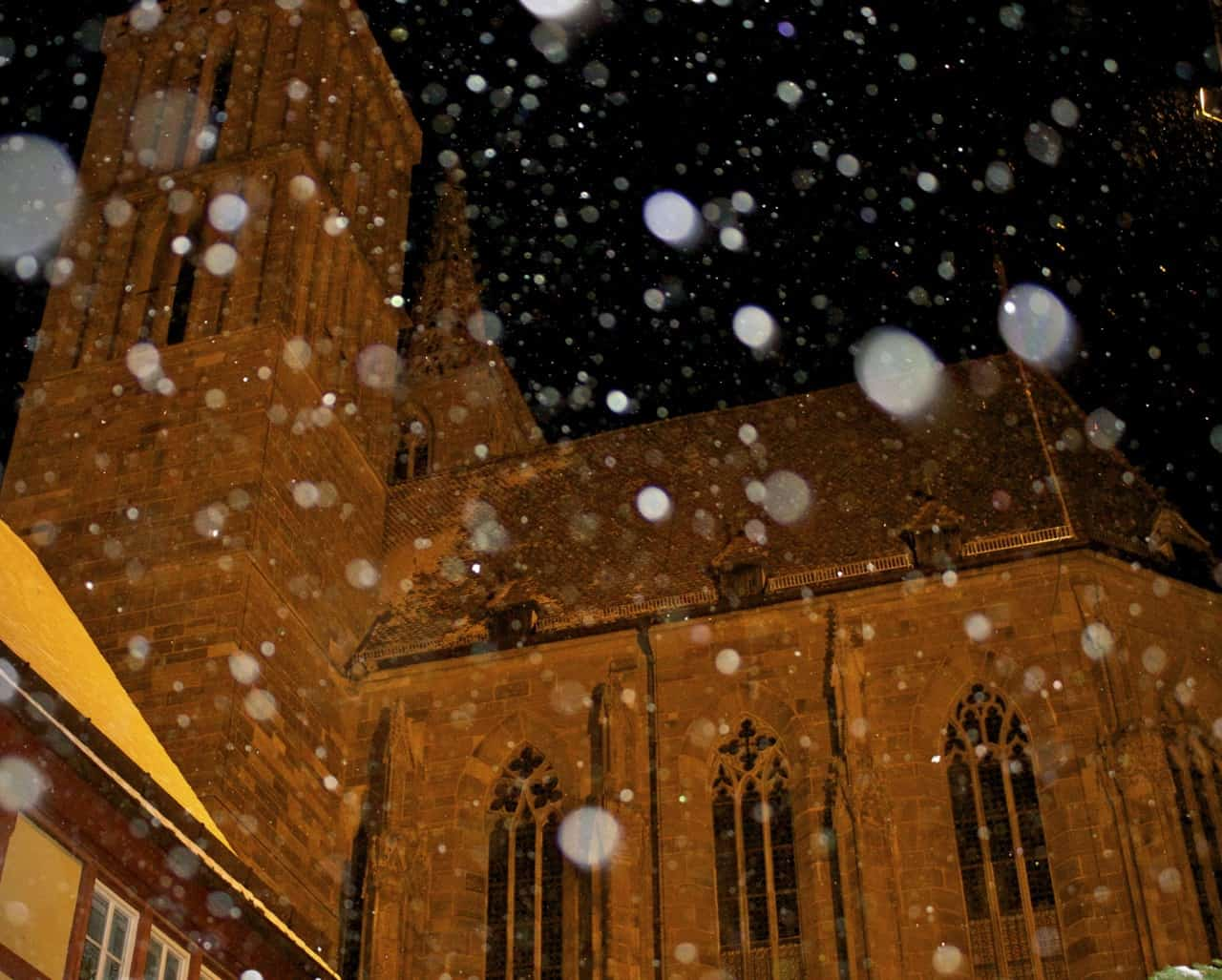 Snow coming down over the church in Rothburg ob der Tauber, Bavaria, Germany