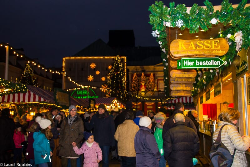 Go to a German Christmas market hungry so that you can try the local specialities and warm up over a mug of Glühwein.