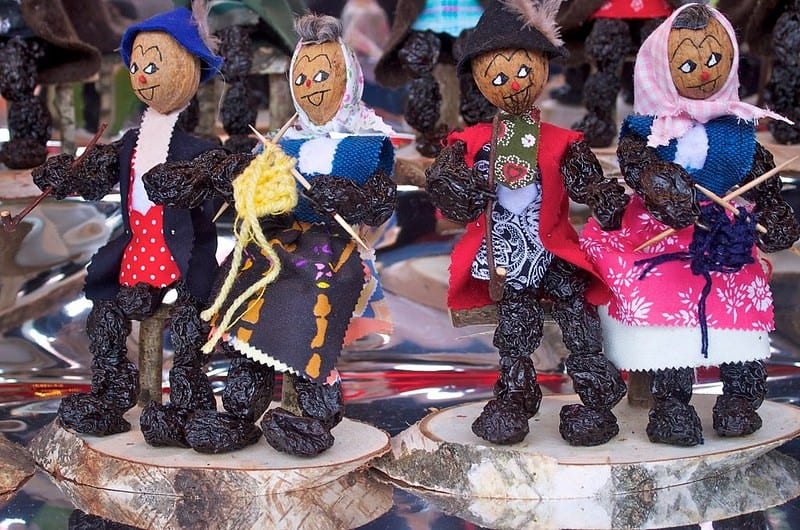 You can purchase prune people, a Christmas speciality at the Nuremberg Christmas Market in Germany.