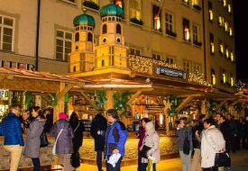 A Glühwein stand that is a replica of the Frauenkirche (church) and in front of it at the Munich Christmas Market.