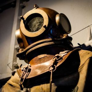 A Historical Diving suit with metal headpiece